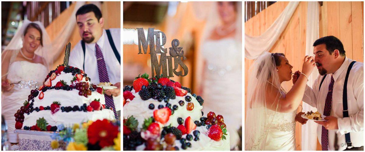 bride feeding groom wedding cake in Stinnett farm barn
