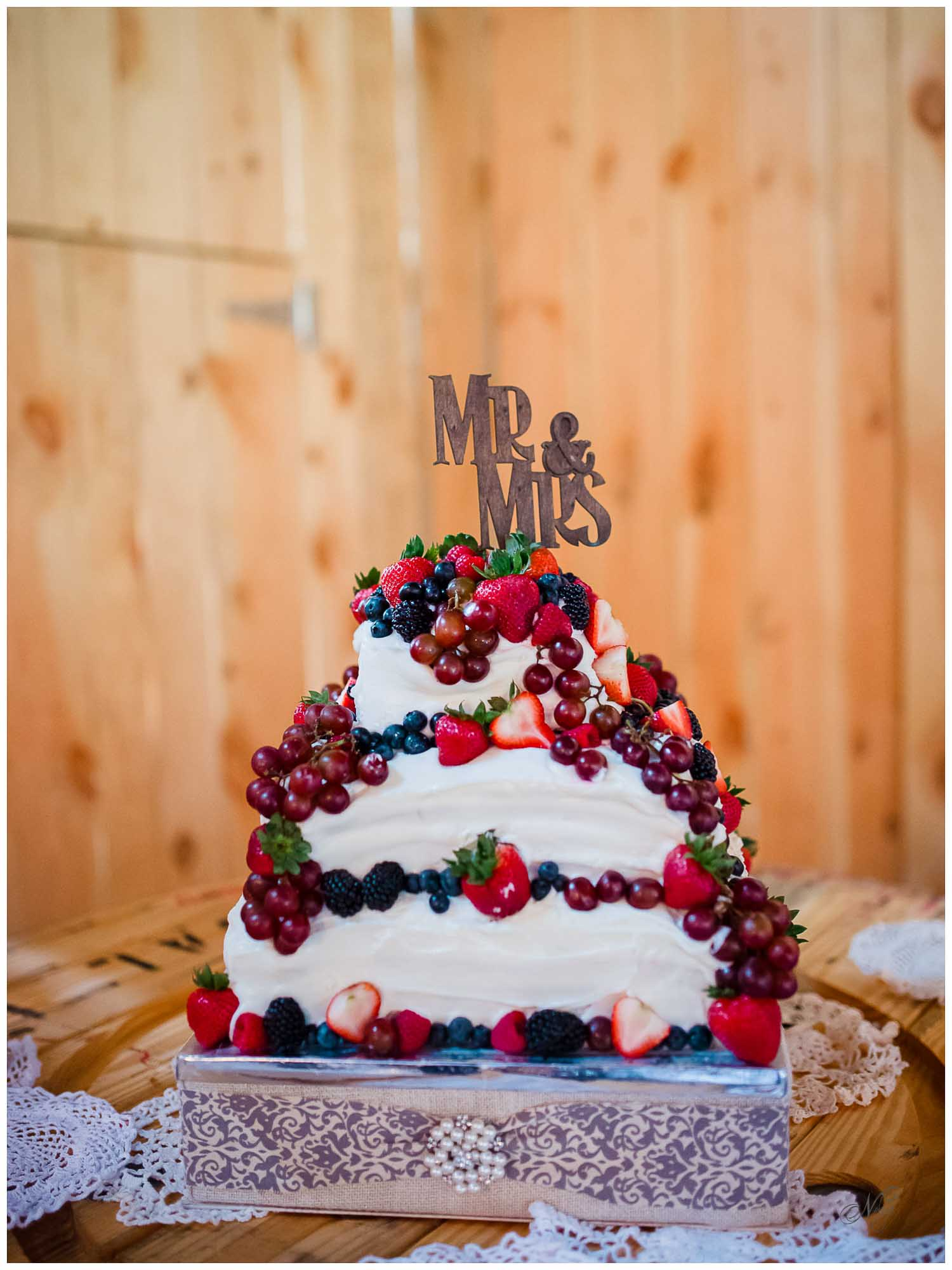 fruit themed wedding cake at Stinnett Farm Barn wedding