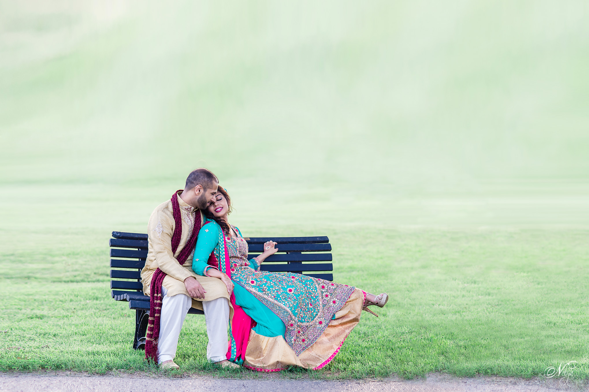 Bride and groom on bench outside Wildwood country club Louisville KY