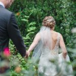 bride leading groom through garden at Rockwood manor on VA