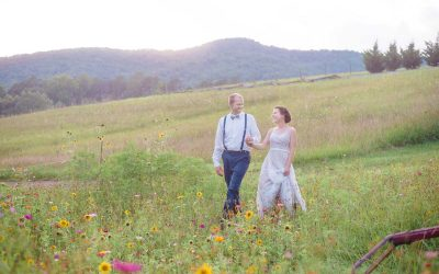 two people walking through wildflowers at Sampsons hollow Wallend TN