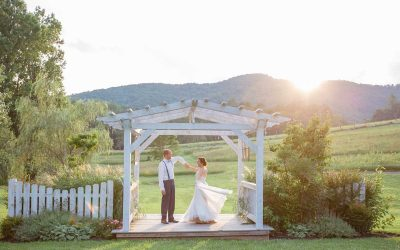wedding couple dancing under pergola