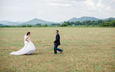 bride running to groom in field in TN
