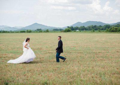 bride running to groom in field in TN