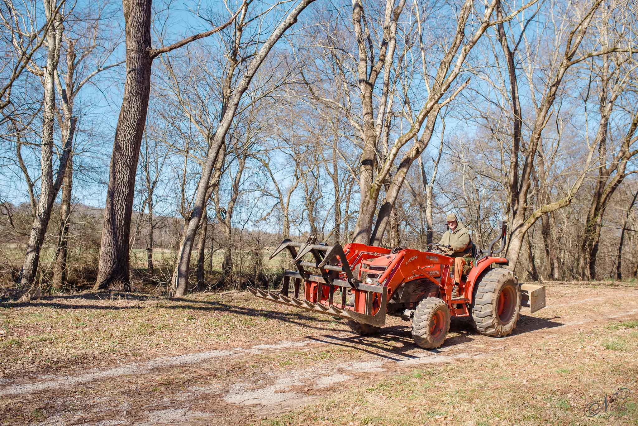Bill and his Kubota at hiwassee river weddings-1318