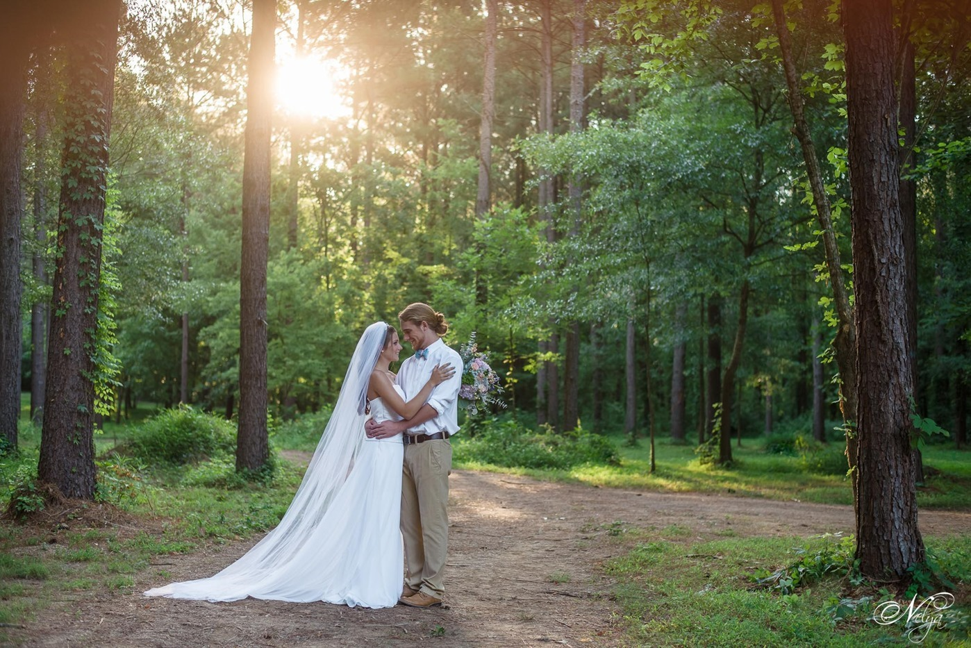 hiwassee river weddings Bride and groom in pines
