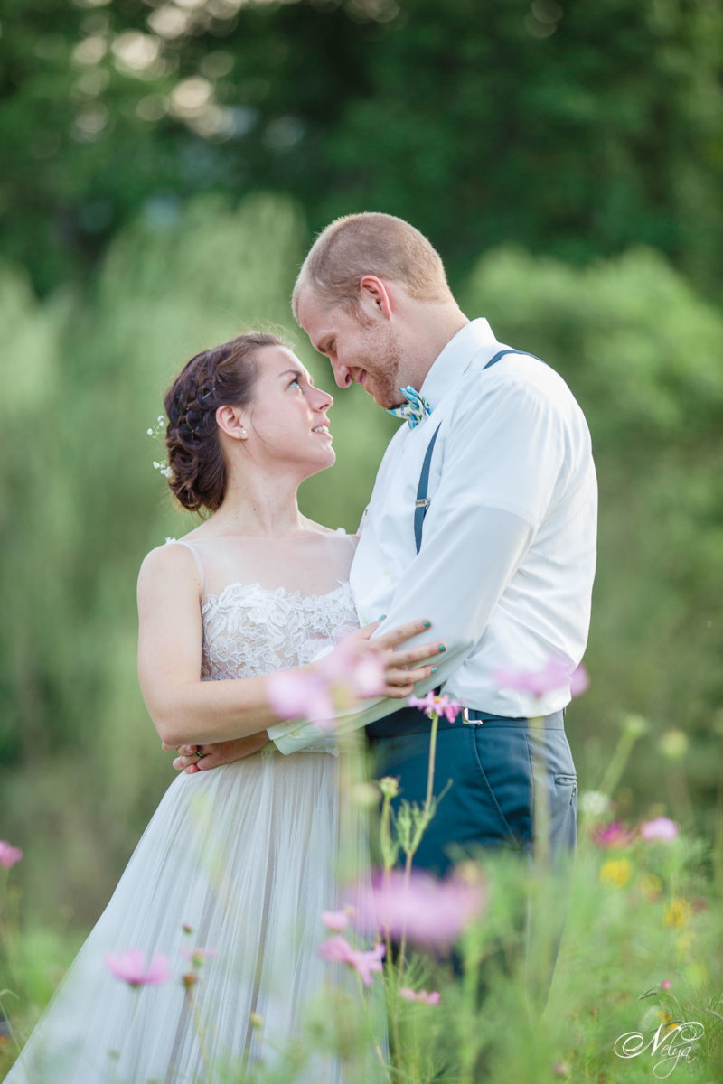 bride and groom in wildflowers at Sampson's hollow