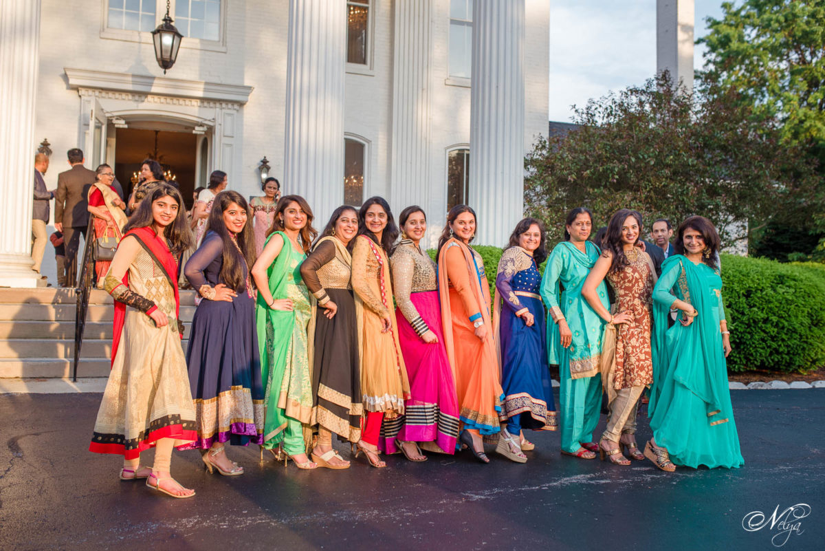 indian wedding guests in front of Griffin Gate Historic 19th Century mansion