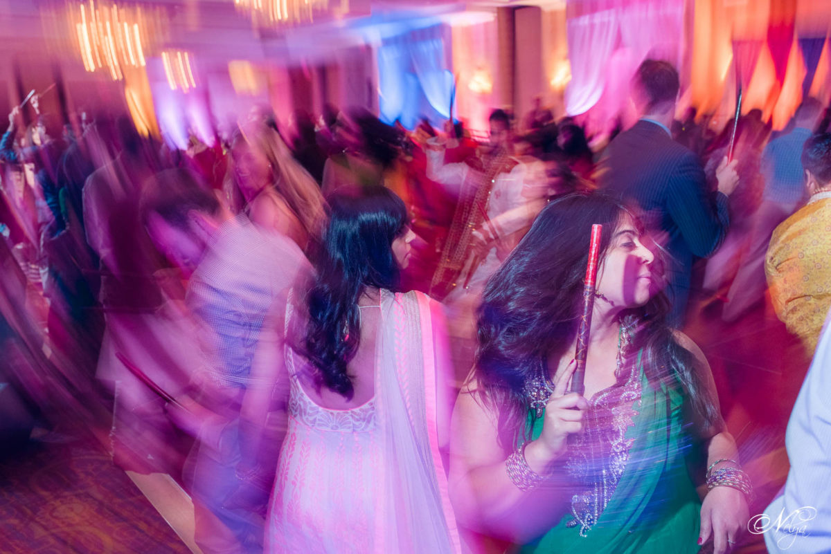 girls dancing raas in grand ballroom at Griffin Gate Marriott