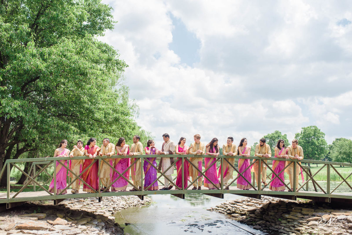 wedding party on bridge on griffin gate golf course