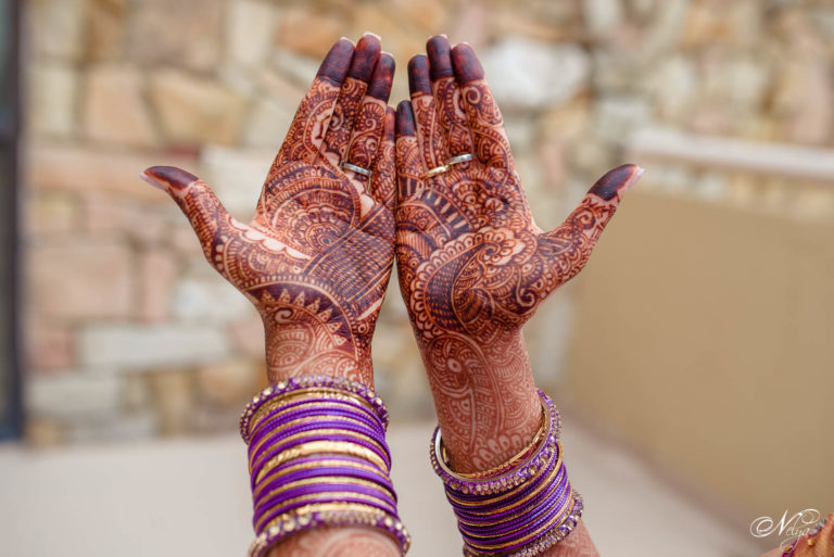 bride's wedding henna desings with purple bangle bracelets at griffin gate marriott