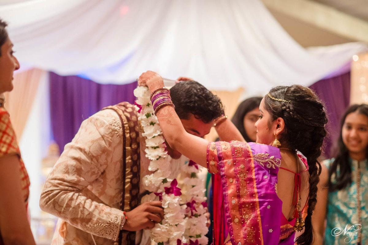 bride and groom Garland Exchange at Griffin Gate wedding ceremony