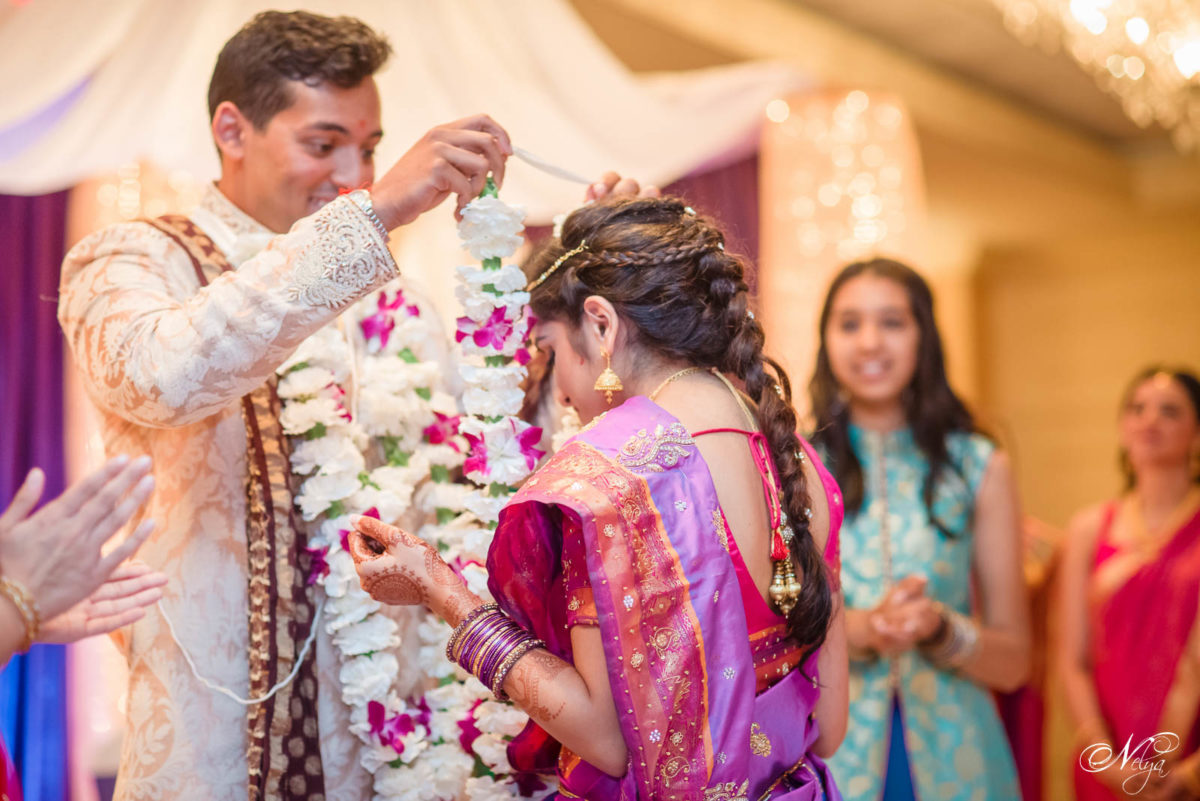 groom and bride Exchanging Garlands at Griffin Gate wedding ceremony