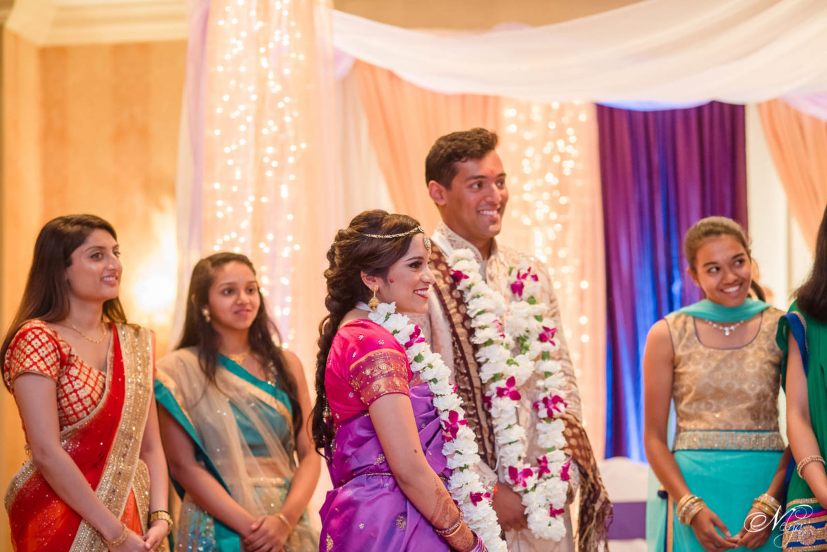 bride and groom smiling during wedding griffin gate ceremony