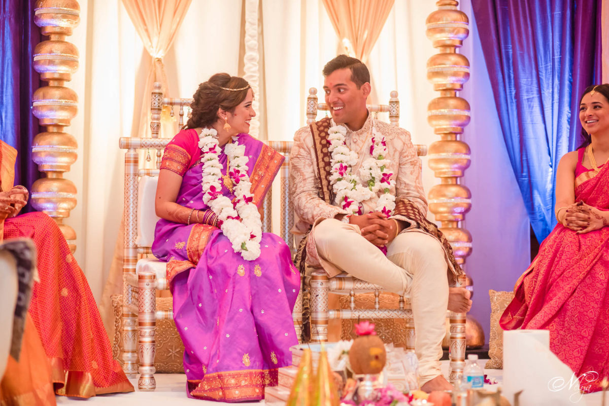 bride and groom sitting during Wedding ceremony at Griffin Gate Marriott