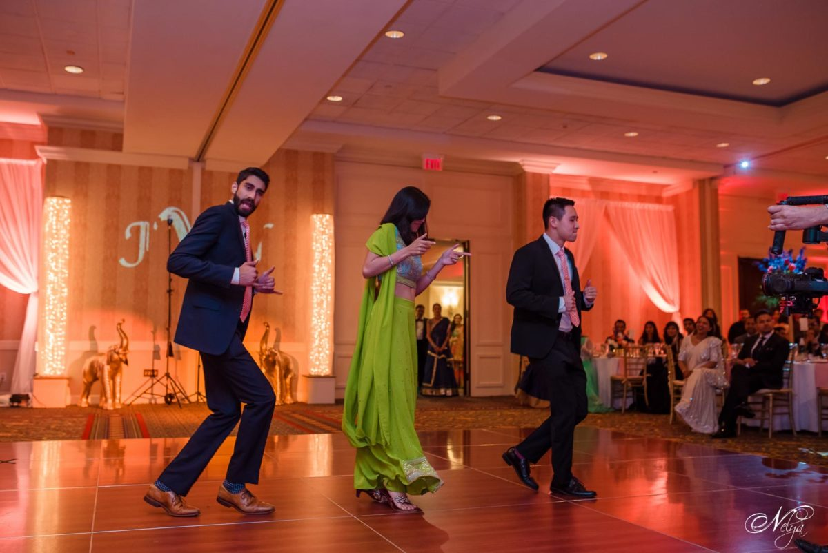wedding party showing their dance moves in the grand ballroom at griffin gate Marriott Lexington KY