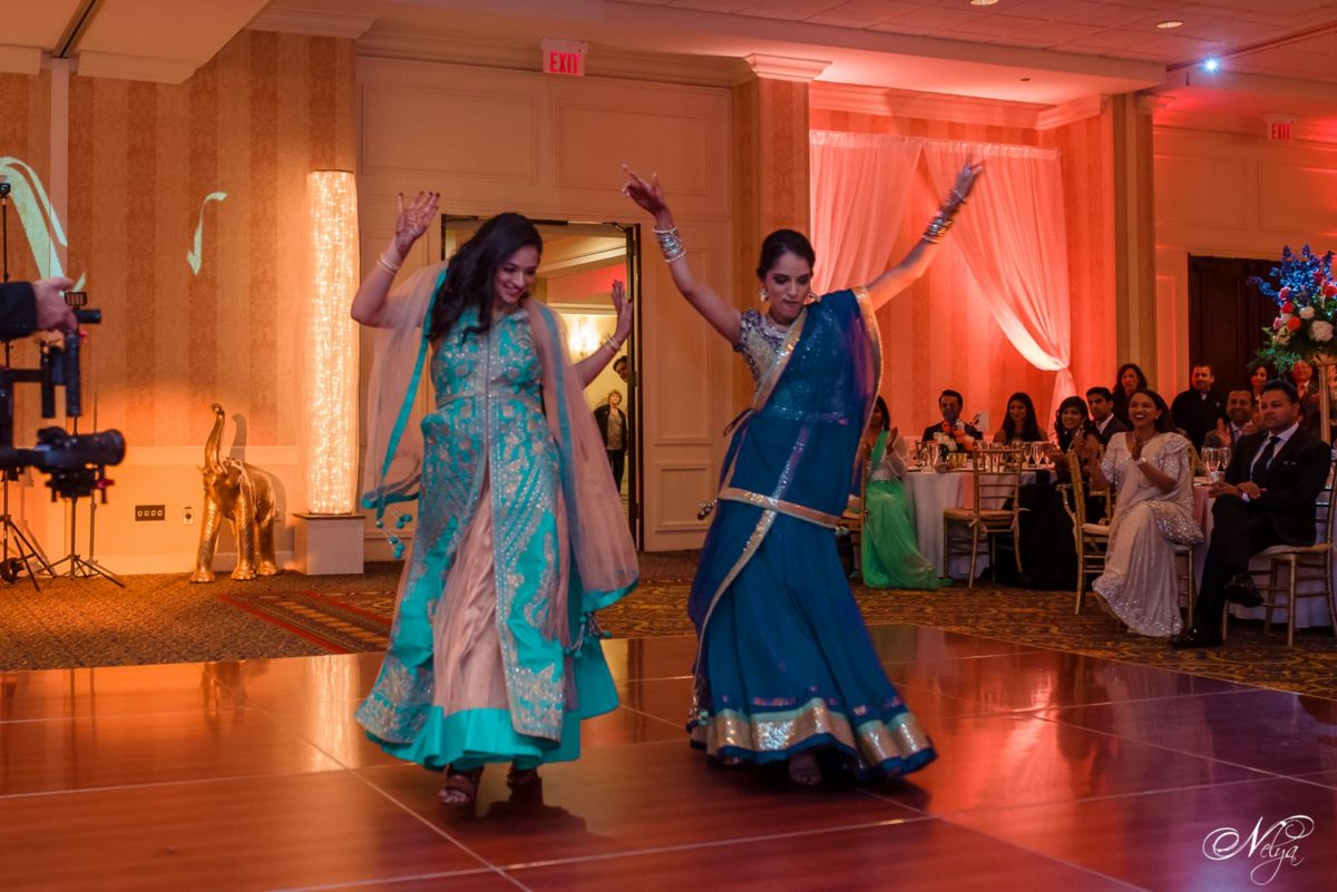 bride and groom's sisters doing a specioal dance during the wedding reception at griffin gate Lexington KY -Photographer: Nelya
