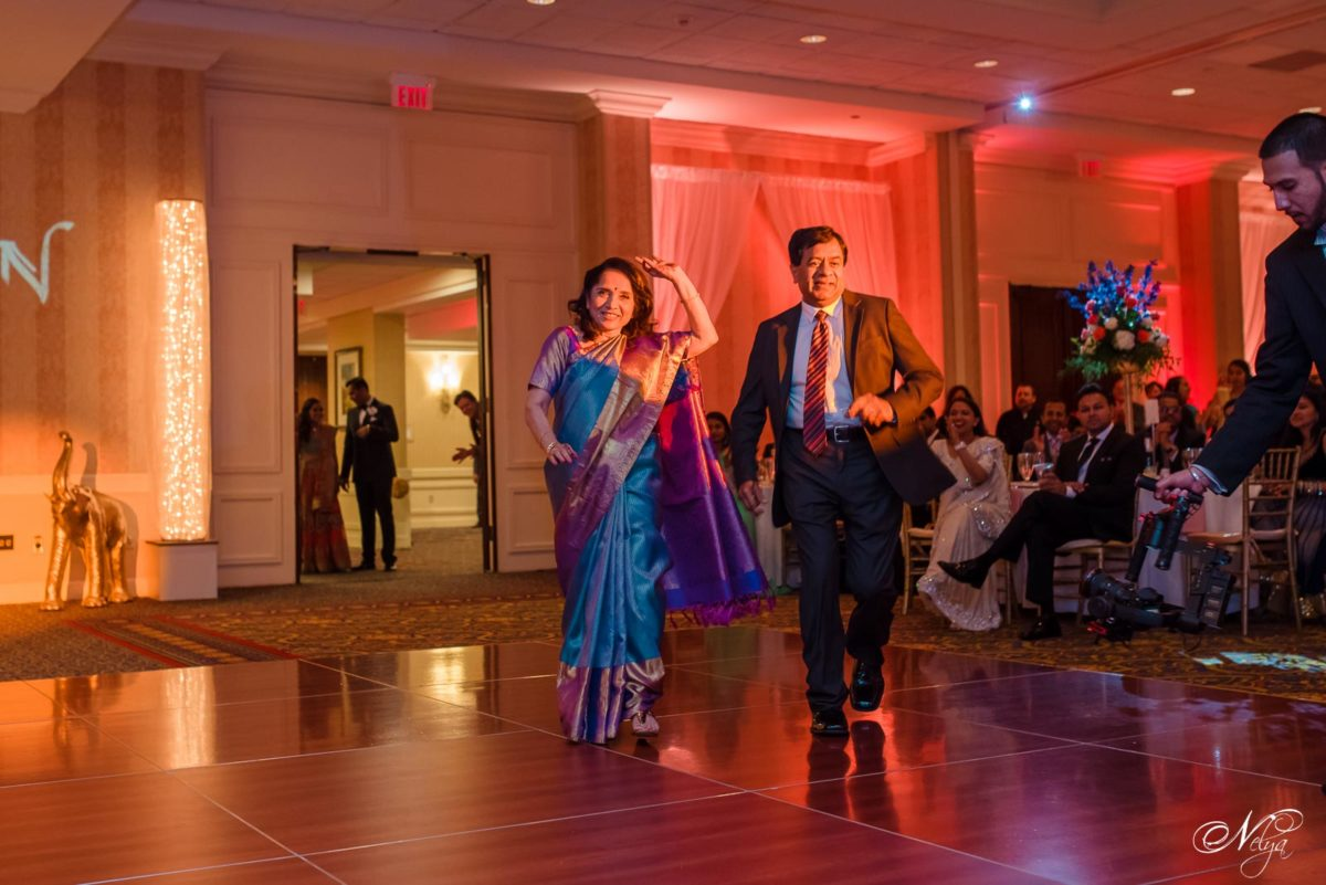 bride's parents come dancing in grand ballroom at griffin gate