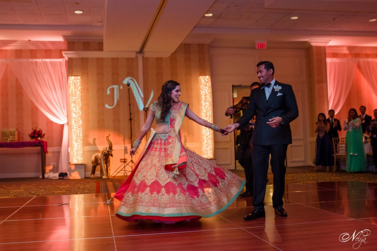 bride and groomdance their way into grand ballroom at Griffin Gate lexington