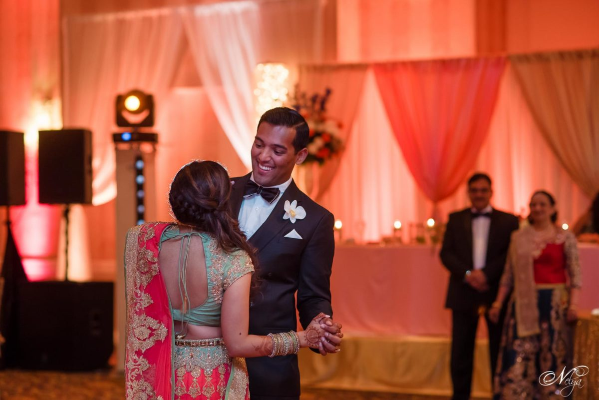 groom smiling at his bride during first dance at griffin gate in Lexington KY