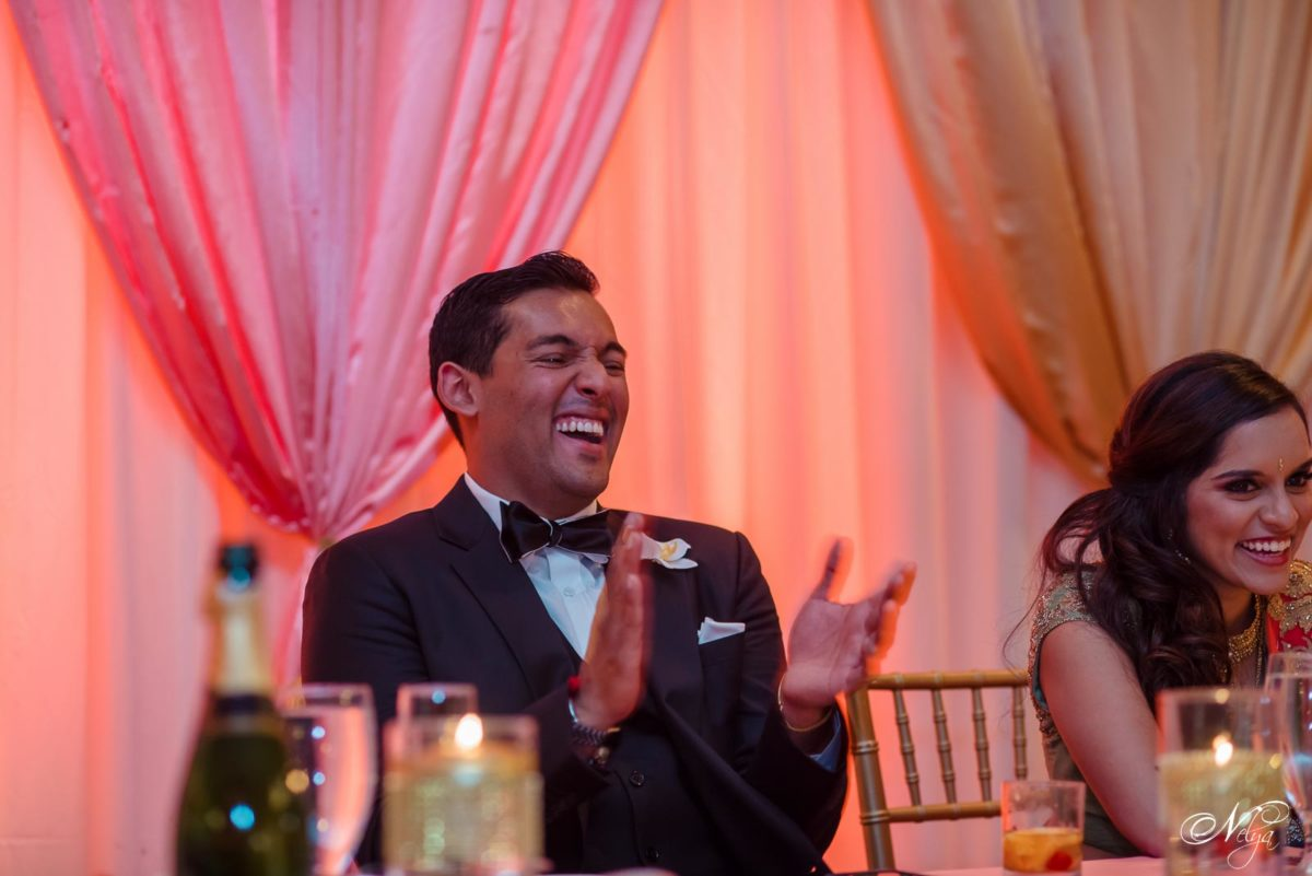 groom laughing during toasts at griffin gate wedding