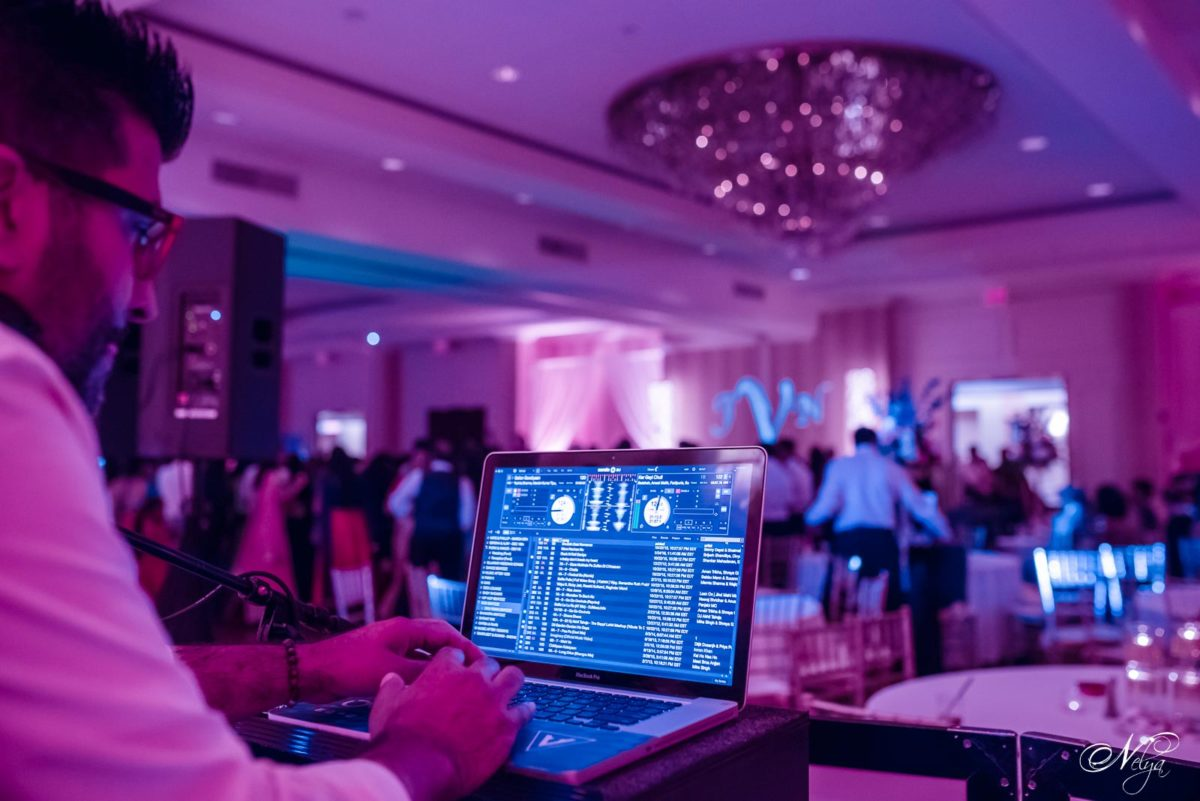 DJ Vikas of Opening Minds Ent getting the party started at the wedding reception at griffin Gate Lexington KY