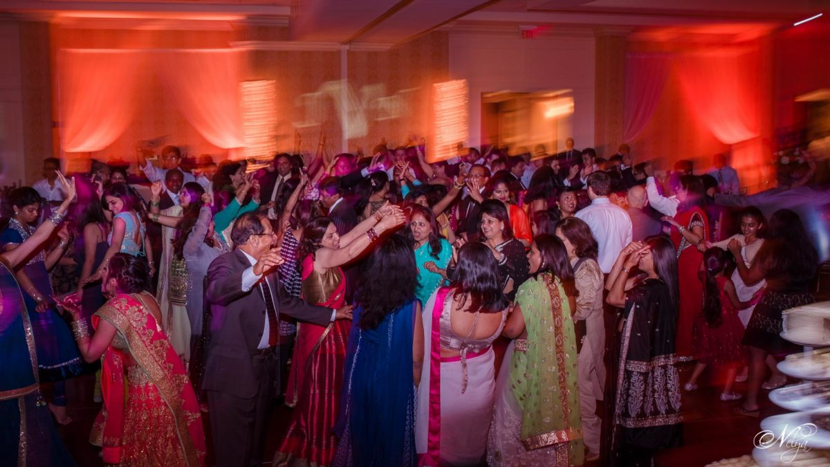 indian wedding reception with all the guests out on the dancefloor dancing and enjoying themselves at Griffin Gate