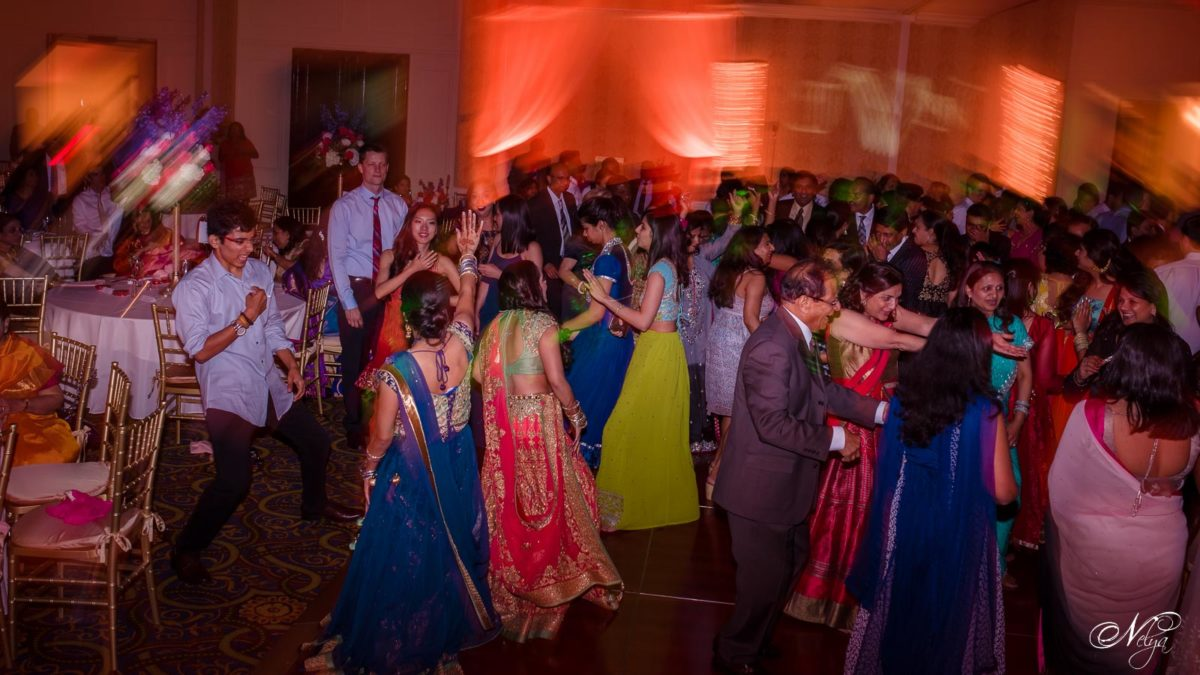 The wedding guests on thedance floor in the grand ballroom at Griffin Gate