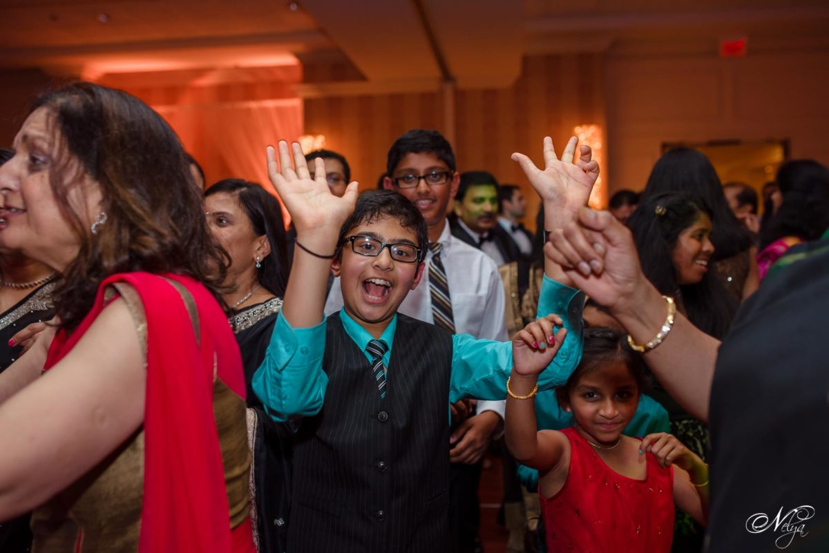 young wedding guests dancing