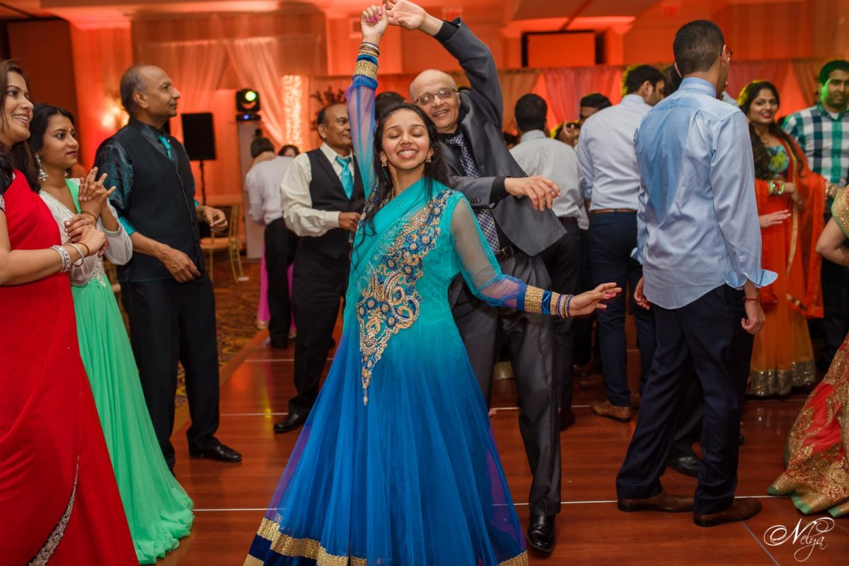 Girl in her turquoise and royal blue dress dances at GRIFFIN GATE WEDDING RECEPTION