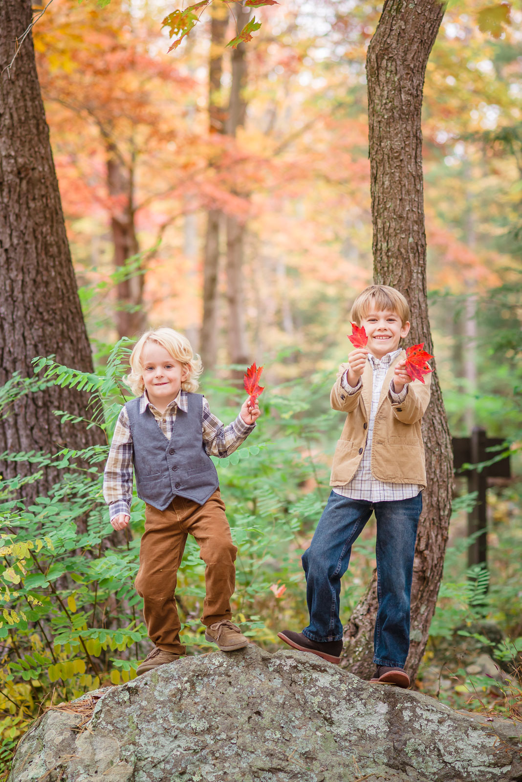 boys-holding-up-red-maple-leaves-at-cades-cove-during-family-photos