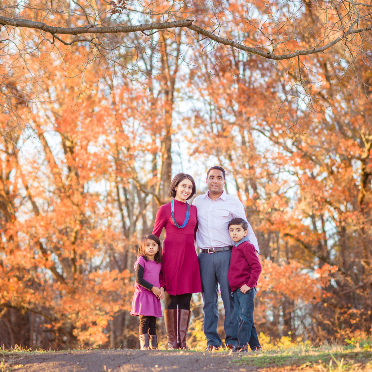 fall family photo with fall foliage at Lenoir City park