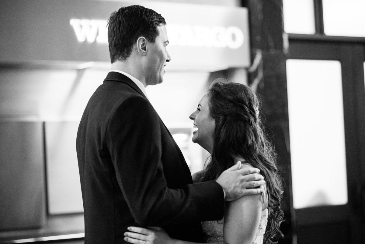 Bride laughing with groom during first look on their weddingday