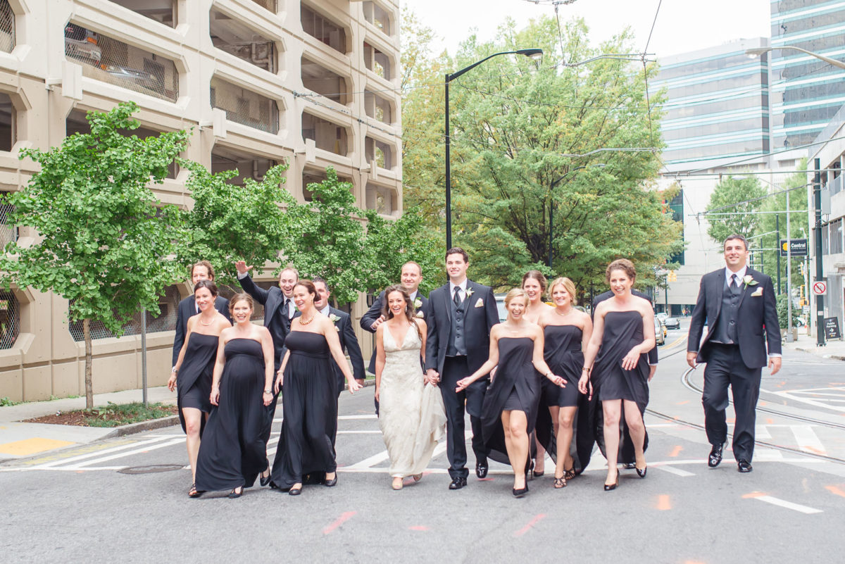 wedding party walking down street by Ritz Carlton in Atlanta