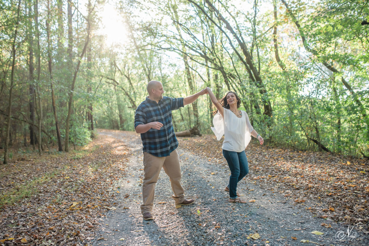 couple dancing on tree covered road at Hiwassee River Weddings in Delano TN