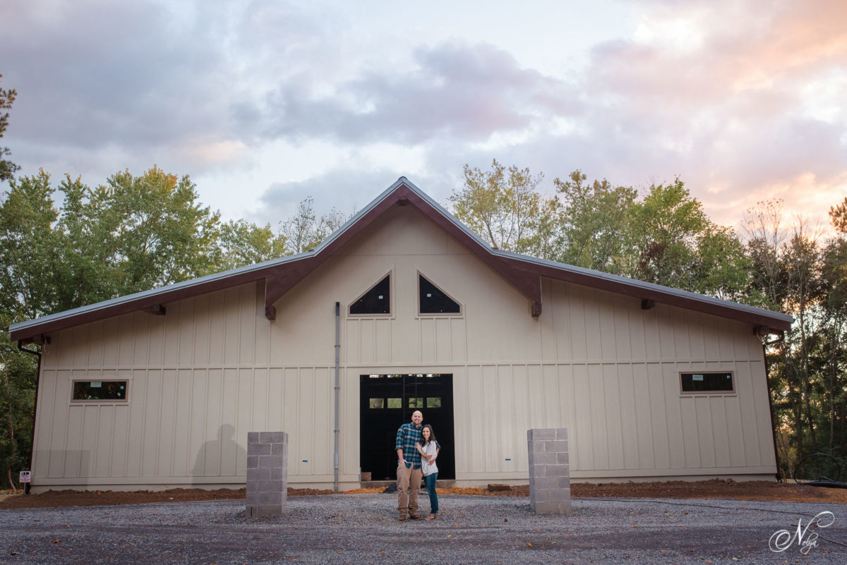 couple standing in Front of the Hiwassee River Weddings wedding venue building