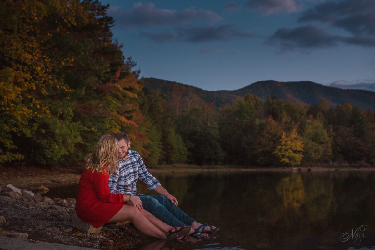 couple sitting on shore with toes in the the water at Indian Boundary Lake Tellico Plains TN