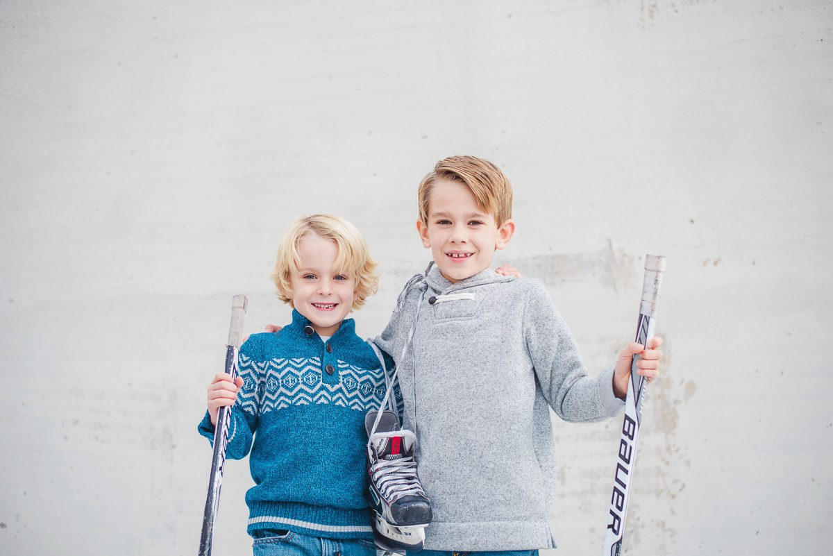 children dressed for hockey themed family photos at Knoxville Civic Coliseum