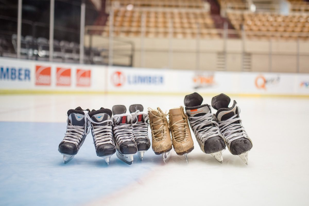 family photo of hockey skates on the ice at Knoxville Civic Cloiseum