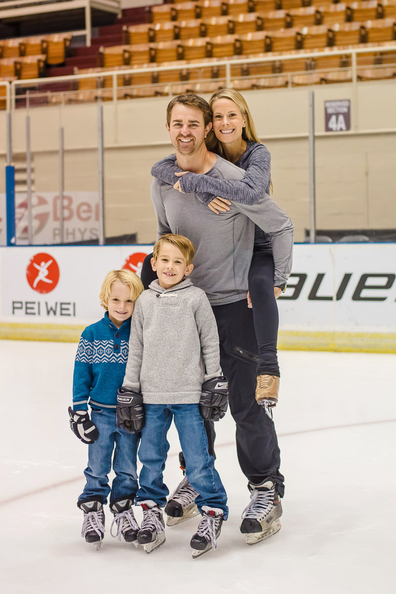 family photo with mom getting a piggy back ride on the ice at Knoxville Civic coliseum