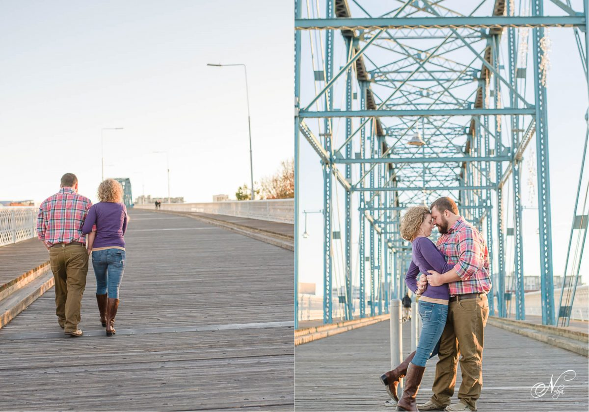 engagened couple walking up walnut st bridge in Chattanooga