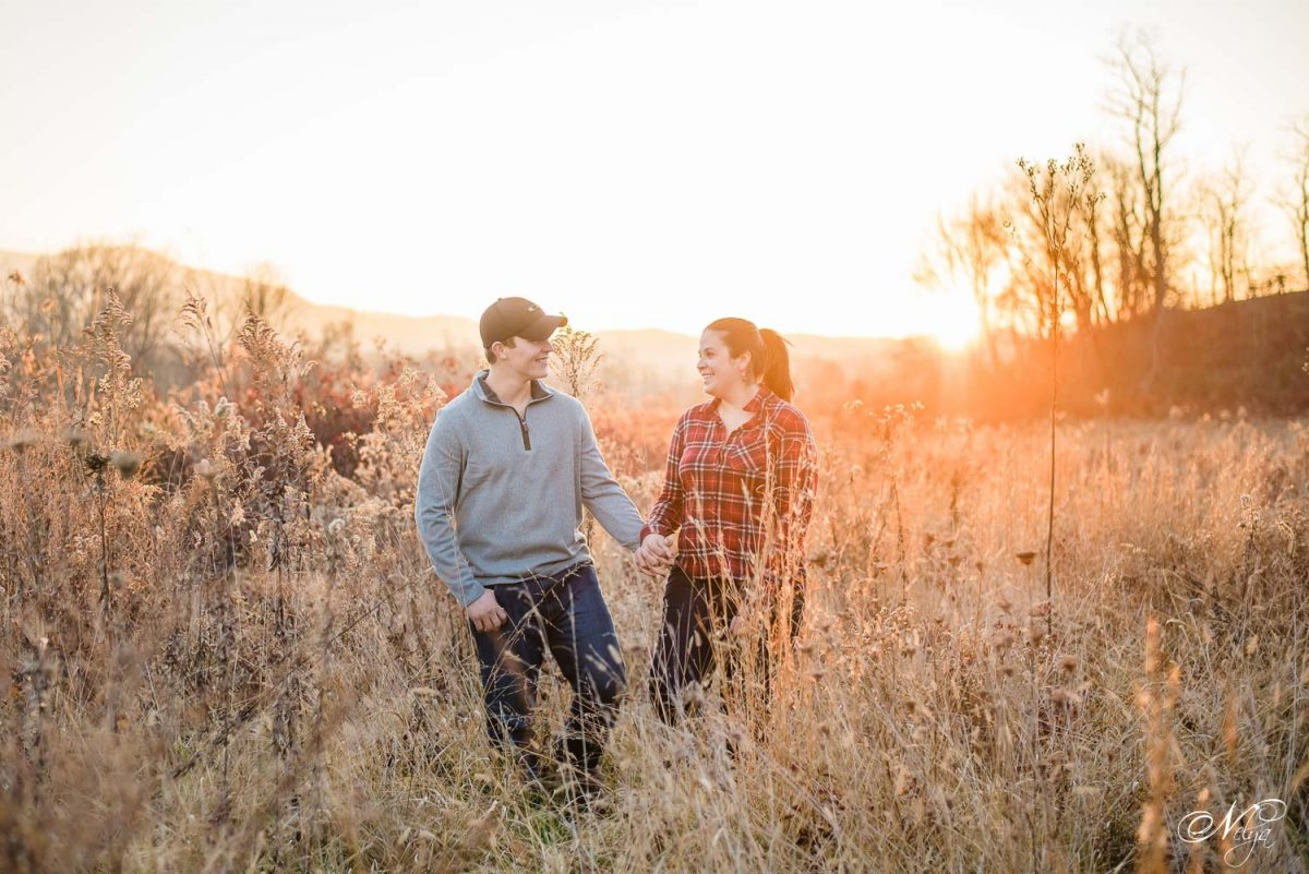 engaged couple walking at sunset in Cade's Cove TN