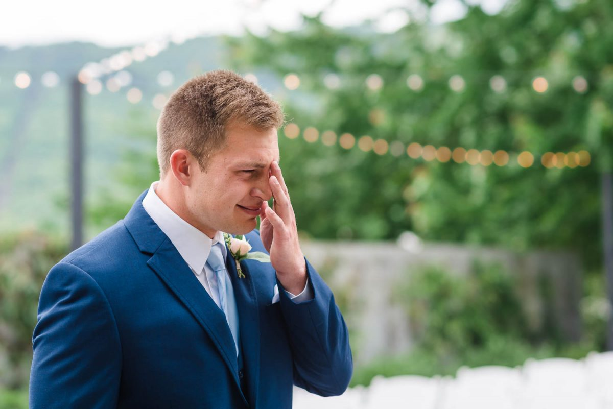 groom wiping a tear away