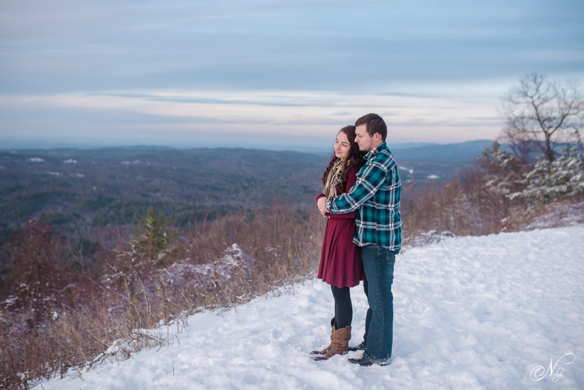 couple watching winter sunset from Indian Boundary overlook on Cherohala Skyway in Tellico Plains TN