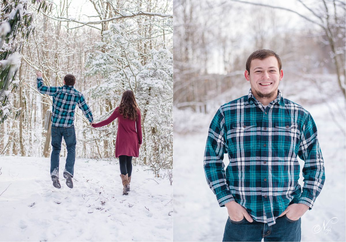 couple walking in snow with guy jumping