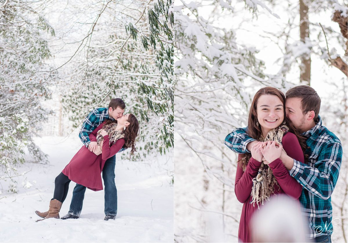 couple kissing in snow on Cherohala Skyway