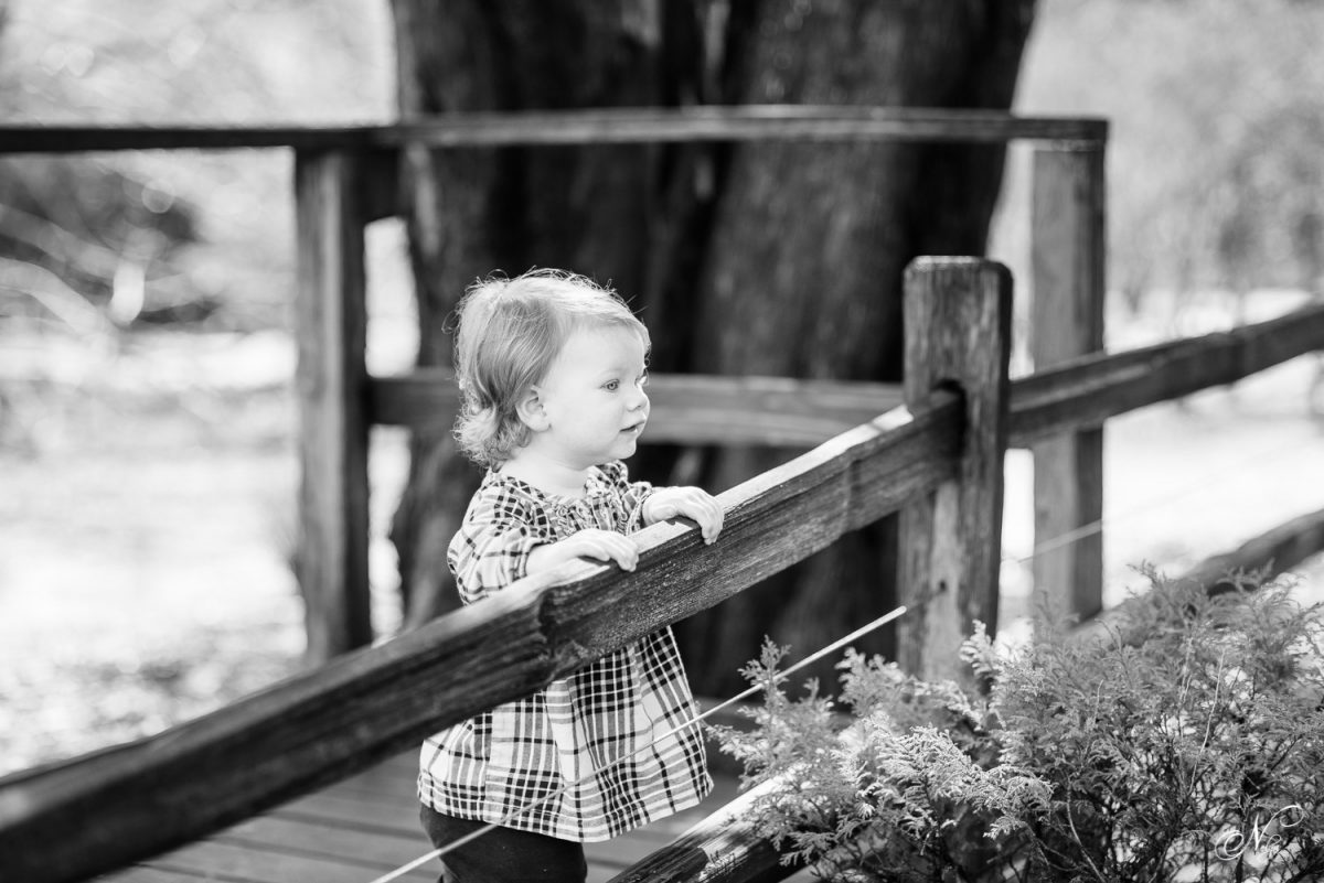 girl watching toy train at Huntsville Botanical Gardens