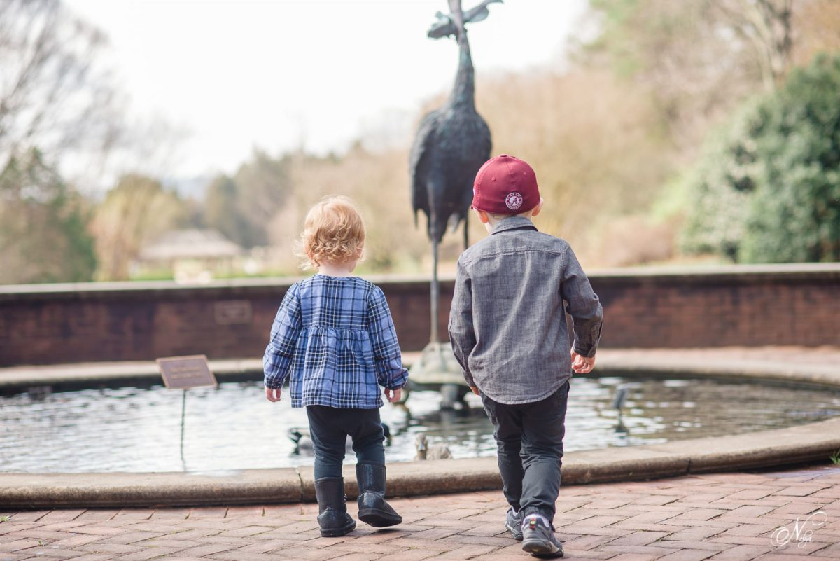 children walking to fountain at Huntsville Botanical gradens