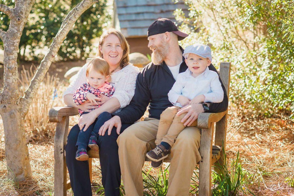 Family sitting on bench Huntsville AL