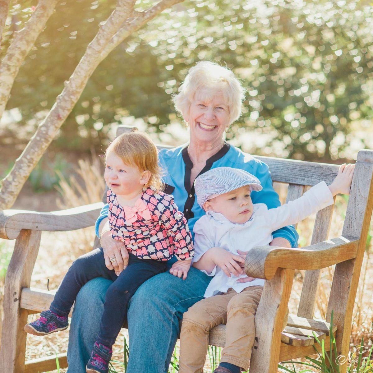 Grandmother and grandchildren on bench at HSVgardens